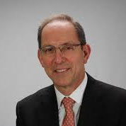 Dr Andrew J. Laster